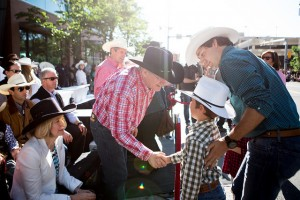 In a rare show of civility, Harper shakes Xavier Trudeau's hand, before turning to crowd and reminding them Trudeau is trying to push pot on their children.